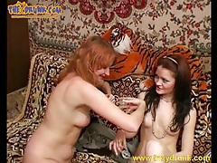Redhead kisses a girl and pisses in the bathtub tubes