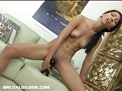 Petite babe Veronica filling her tight pussy with a giant dildo tubes