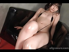 Tiny swimsuit on fully oiled up Japanese girl tubes