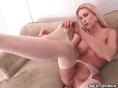 Chick with fake tits tears apart her pantyhose tubes