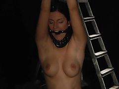 Young stunning Mira in a slave trap tubes