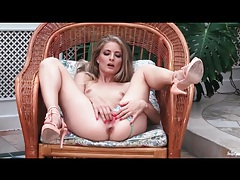 Solo skinny girl in sexy heels fingers pussy tubes