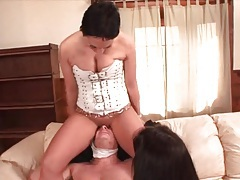 Girls in corsets sit on his face and give footjob tubes