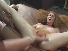 Limber redhead with big fake titties laid tubes