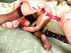 Dildo shared by two hotties in lingerie tubes