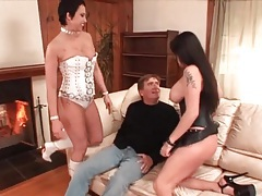 Two busty babes in corsets dominate him tubes