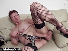 Old busty and horny mom is wanking her pussy while squeezing and licking her big boobs tubes