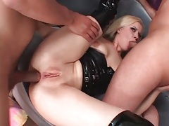 Cumshot collecting girl in black latex tubes
