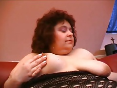 Fat mature strips and fucks toy into her vagina tubes