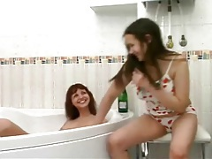 Teens wash each other in the bathtub tubes