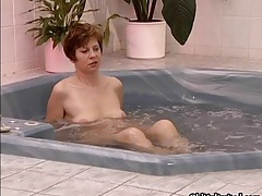 Nasty brunette mature slut gets horny in the jacuzzi tubes