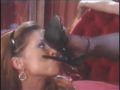 Latex mistress drips hot wax on sub feet tubes