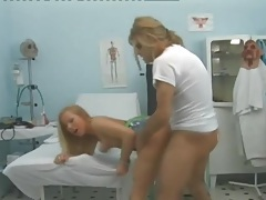 Gorgeous patient laid by the doctor in exam room tubes