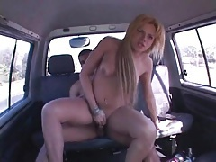 Car drives down highway as shemale rides cock tubes