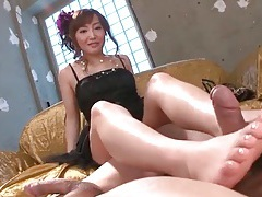 Well dressed japanese girl gives footjob and handjobs tubes