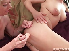 Young lady stuffs mature pussy full of dildo tubes