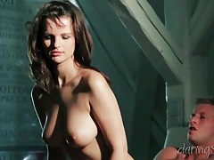 Big tits brunette erotically sits on a big cock tubes