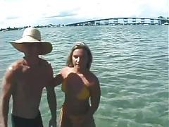 Bikini girl gives him a blowjob in the ocean tubes