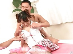 Pulling off her schoolgirl uniform and fingering her tubes