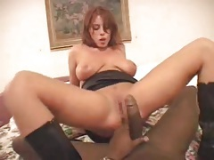 Hot redhead in black leather boots rides black cock tubes