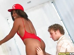 Black chick in red swimsuit licked and fucked tubes