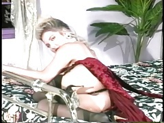Glamorous huge tits 80s pornstar chick in stockings tubes