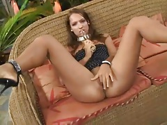 Moaning and masturbating as she toys her vagina tubes