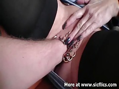 Fist fucking her heavily pierced gaping cunt tubes