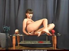 Big titty babe masturbates on coffee table tubes