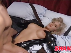 Cocksucking blonde in a black latex catsuit tubes