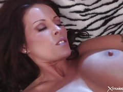 Lesbian pornstar with big tits fucks pussy with toy tubes