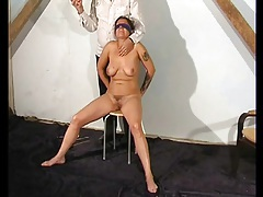 Blindfolded and bound girl taking hot wax play tubes