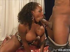 Ebony babe with big tits fucks and sucks tubes