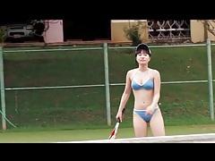 Japanese beauty plays bikini on tennis court tubes