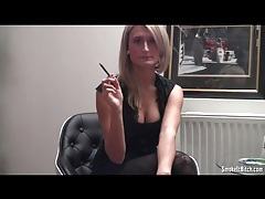 Girl in tights and a sexy top smokes a cigarette tubes