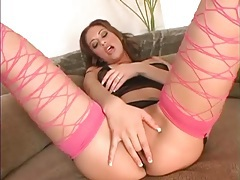 Sheer black lingerie and sexy pink fishnets on her tubes