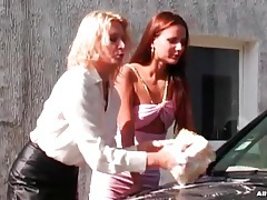 Girls in sexy outfits wash the car outdoors tubes