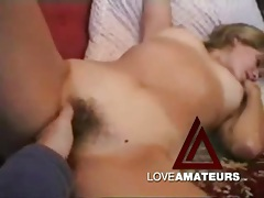 Finger fucking her hairy amateur pussy in bed tubes