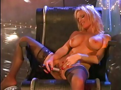 Beautiful blonde bimbo in stockings toys her vagina tubes
