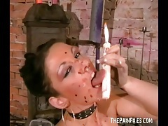 Solo girl with hot wax over her body and in her mouth tubes