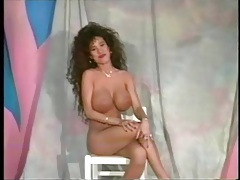 Stripping brunette with big fake tits is tasty tubes