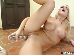 Sexy milf fucks herself hard with huge glass dildo tubes