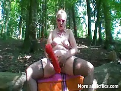 Extreme fisting and giant dildo fucking outdoors tube