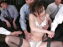 Many hands fondle a hottie and vibrate her pussy tubes