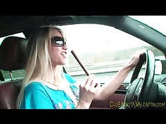 Sexy chick eating beef jerky in the car tubes