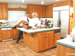 Blonde slut in short skirt gives up holes in kitchen tubes