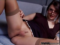 Classy gal in a pair of glasses rubs her pussy tubes