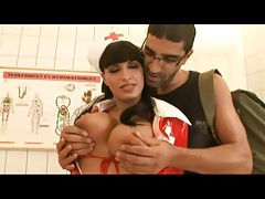 Nurse in red latex lets him suck her big titties tubes