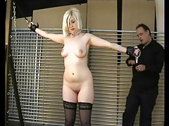 He binds her hands and plays with her pussy tubes