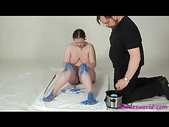Hot blue wax dripped all over her body tubes